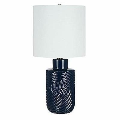 table lamp with textured ceramic base bulb